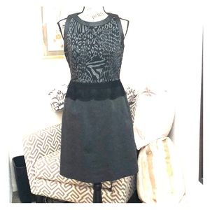 Knee length  lined dress. Lace/leather trim.